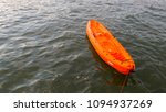 Orange Kayak On The Sea
