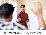 asian businessman giving... | Shutterstock . vector #1094991950