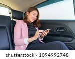 asian woman talk by mobile... | Shutterstock . vector #1094992748