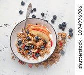 bowl of granola with yogurt and ... | Shutterstock . vector #1094996906