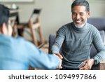 confident muture asian man... | Shutterstock . vector #1094997866
