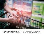 holding smart phone shopping  ... | Shutterstock . vector #1094998544