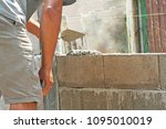 bricklayer worker  installing... | Shutterstock . vector #1095010019
