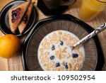 The words I LOVE YOU spelled out of letter shaped cereal pieces floating in a milk filled cereal bowl. - stock photo