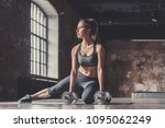 athletic girl with dumbbells in ... | Shutterstock . vector #1095062249
