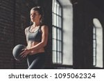sporty young girl with a ball...   Shutterstock . vector #1095062324