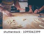 italian women make homemade... | Shutterstock . vector #1095062399