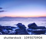 the stony beach and cliff of... | Shutterstock . vector #1095070904