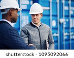 two engineers wearing hardhats... | Shutterstock . vector #1095092066