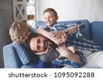 portrait of smiling father and...   Shutterstock . vector #1095092288