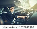 smiling young businessman... | Shutterstock . vector #1095092900