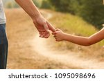 the parent holds the hand of a... | Shutterstock . vector #1095098696