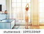 woman in a futuristic white... | Shutterstock . vector #1095133469