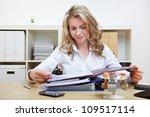 blonde hr woman reading...   Shutterstock . vector #109517114