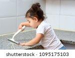 little cute baby girl washing... | Shutterstock . vector #1095175103