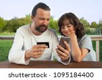 family shopping online in the... | Shutterstock . vector #1095184400