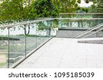 Small photo of tempered laminated glass railing balustrade panels frame less ,safety glass for modern architectural buildings.