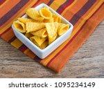 corn cones on wood background   Shutterstock . vector #1095234149