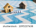 miniature house model with ... | Shutterstock . vector #1095237638