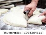 male baker using kitchen... | Shutterstock . vector #1095254813
