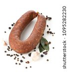 Small photo of German specialty salami hard cured sausage whole with spices over white background
