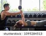 fitness man and asian woman... | Shutterstock . vector #1095284513