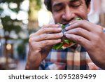 closeup of a hungry young man... | Shutterstock . vector #1095289499