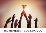 winning team is holding trophy... | Shutterstock . vector #1095297200