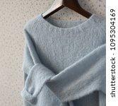 pastel blue knitted woolen... | Shutterstock . vector #1095304169