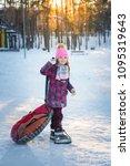 pretty little girl in her ski... | Shutterstock . vector #1095319643