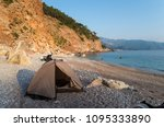 camping by the sea at sunset.... | Shutterstock . vector #1095333890