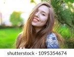 smiling woman near cedar wood...   Shutterstock . vector #1095354674