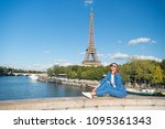 happy woman sit at river on... | Shutterstock . vector #1095361343