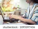 a businesswoman is looking at a ...   Shutterstock . vector #1095397436