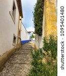 streets of obidos. portugal.... | Shutterstock . vector #1095401480