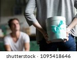 woman hiding present behind...   Shutterstock . vector #1095418646