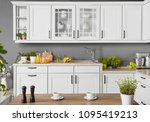 Stock photo front view of a modern kitchen 1095419213