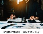 an accountant man holding pen... | Shutterstock . vector #1095450419