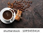 coffee beans and cinnamon on a... | Shutterstock . vector #1095455414