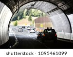 cars passing tunnel under a... | Shutterstock . vector #1095461099