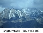 mountains with melting snow... | Shutterstock . vector #1095461183