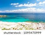 blue lagoon in kassiopi in... | Shutterstock . vector #1095470999