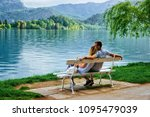 romantic couple sitting on the... | Shutterstock . vector #1095479039