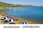 sunbeds and umbrellas on the... | Shutterstock . vector #1095483590