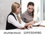 Small photo of Two Beautiful Attractive Caucasian young business woman discuss about they work to get requirement and idea in meeting day in the office,Business Teamwork Concept