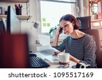 worried woman sitting by the... | Shutterstock . vector #1095517169