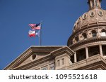 the texas flag and usa flag fly ... | Shutterstock . vector #1095521618