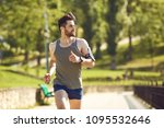 a young male runner jogs in the ... | Shutterstock . vector #1095532646