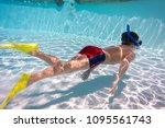 boy in mask and flippers dive... | Shutterstock . vector #1095561743