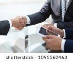 handshake of proven partners | Shutterstock . vector #1095562463